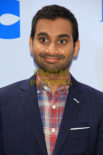 Aziz Ansari.attending the New York film premiere of 'Epic' at the Ziegfeld Theatre, New York, NY, May 18th, 2013..portrait headshot beard facial hair blue suit red tartan plaid checked shirt .CAP/LNC/TOM.©TOM/LNC/Capital Pictures.