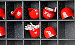 28 February 2011: Washington Nationals' Batting Helmets rest in their dugout shelves during a Spring Training game against the New York Mets at Digital Domain Park in Port St. Lucie, Florida. The Nationals defeated the Mets 9-3 in Grapefruit League action. Mandatory Credit: Ed Wolfstein Photo