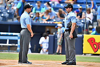 First base umpire Mark Stewart and home plate umpire Matthew Brown before a game between the Augusta GreenJackets and the Asheville Tourists at McCormick Field on July 16, 2017 in Asheville, North Carolina. The GreenJackets defeated the Tourists 10-9. (Tony Farlow/Four Seam Images)