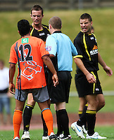 Wellington's Trent Watson and Chris Davies argue with Waikato's Sam Wilkinson..NZFC soccer  - Team Wellington v Waikato FC at Newtown Park, Wellington. Sunday, 20 December 2009. Photo: Dave Lintott/lintottphoto.co.nz