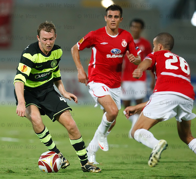 Aiden McGeady drifts past the Hapoel defence