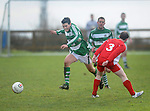 David O' Brien slips the ball past Lifford's Eoin Judge. Photograph by Declan Monaghan