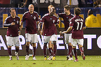Omar Cummings of the Colorado Rapids is congratualed by teammates after scoring a goal. The Colorado Rapids defeated the LA Galaxy 3-2 at Home Depot Center stadium in Carson, California on Saturday October 16, 2010.