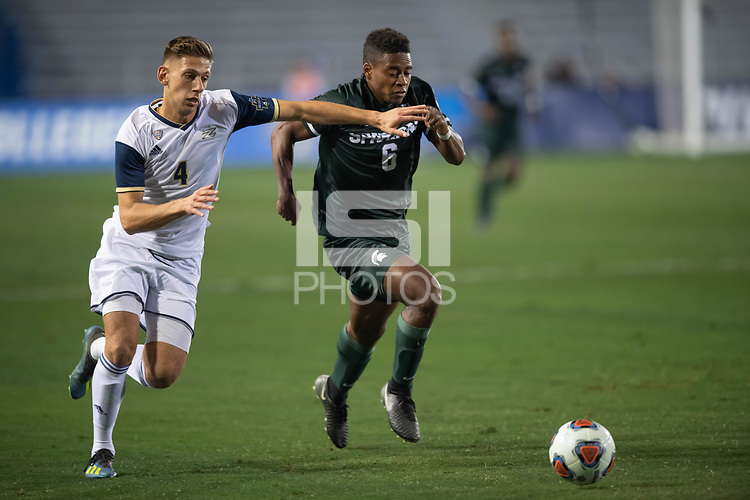 Santa Barbara, CA - Friday, December 7, 2018:  Akron men's soccer defeated Michigan State 5-1 in a semi-final match in the 2018 College Cup.  Akron's Marco Milanese defends Michigan State's Delan Jones.