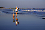 Family walking on the beach at Cape Hatteras National Seashore, North Carolina, USA