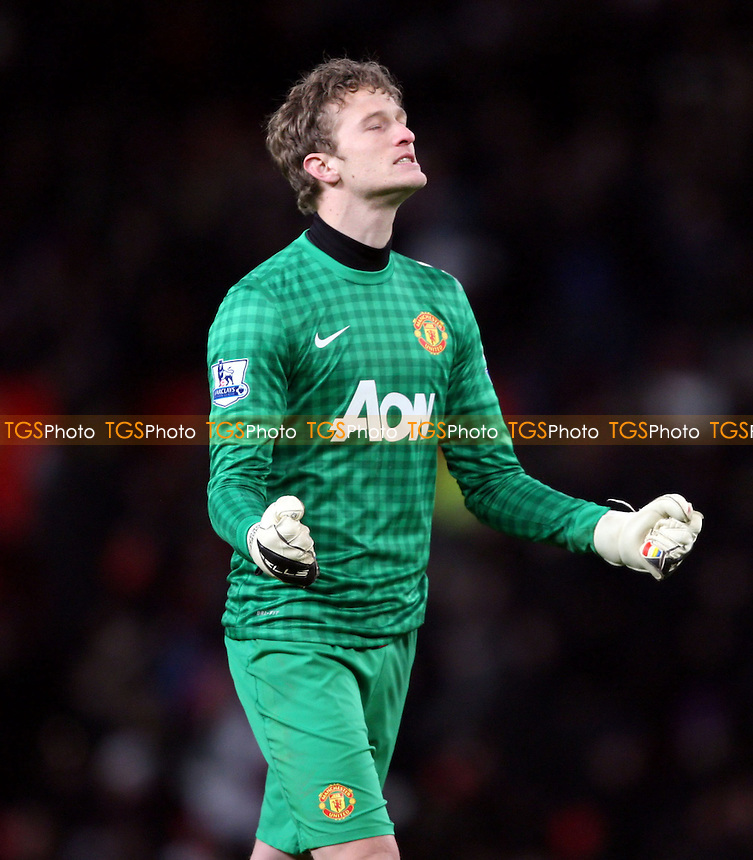 Anders Lindegaard celebrates Man Utd's victory - Manchester United vs West Ham United, FA Cup 3rd Round Replay at Old Trafford, Manchester - 16/01/13 - MANDATORY CREDIT: Rob Newell/TGSPHOTO - Self billing applies where appropriate - 0845 094 6026 - contact@tgsphoto.co.uk - NO UNPAID USE.
