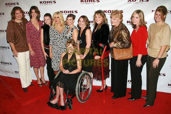 TORI SPELLING & TRANSFORMATION NATION CONTESTANTS.Kohl's and Conde Nast Host Kohl's Transformation Nation Fall Fashion Show - Arrivals held at the Santa Monica Pier, Santa Monica, California, USA..October 12th, 2006.Ref: ADM/ZL.full length wheelchair .www.capitalpictures.com.sales@capitalpictures.com.©Zach Lipp/AdMedia/Capital Pictures.