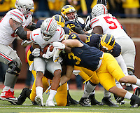 Ohio State Buckeyes wide receiver Braxton Miller (1) gets stuffed on a rushing attempt by Michigan Wolverines linebacker Desmond Morgan (3) during the NCAA football game at Michigan Stadium in Ann Arbor on Nov. 28, 2015. Ohio State won 42-13. (Adam Cairns / The Columbus Dispatch)
