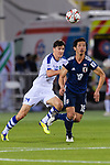 Tsukasa Shiotani of Japan (R) competes for the ball with Eldor Shomurodov of Uzbekistan (L) during the AFC Asian Cup UAE 2019 Group F match between Japan (JPN) and Uzbekistan (UZB) at Khalifa Bin Zayed Stadium on 17 January 2019 in Al Ain, United Arab Emirates. Photo by Marcio Rodrigo Machado / Power Sport Images