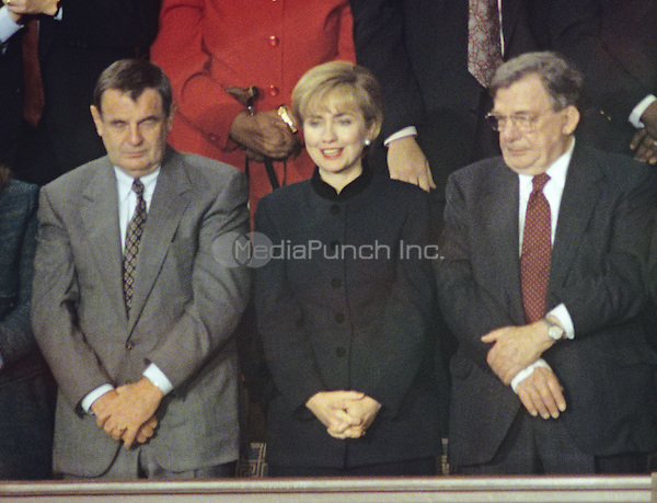 First lady Hillary Rodham Clinton, center, stands during United States President Bill Clinton's State of the Union Address to a Joint Session of Congress in the U.S. Capitol on January 25, 1994.  With Mrs. Clinton are General Motors Chairman and CEO John Smith, left, and AFL-CIO President Lane Kirkland, right.<br /> Credit: Ron Sachs / CNP/MediaPunch