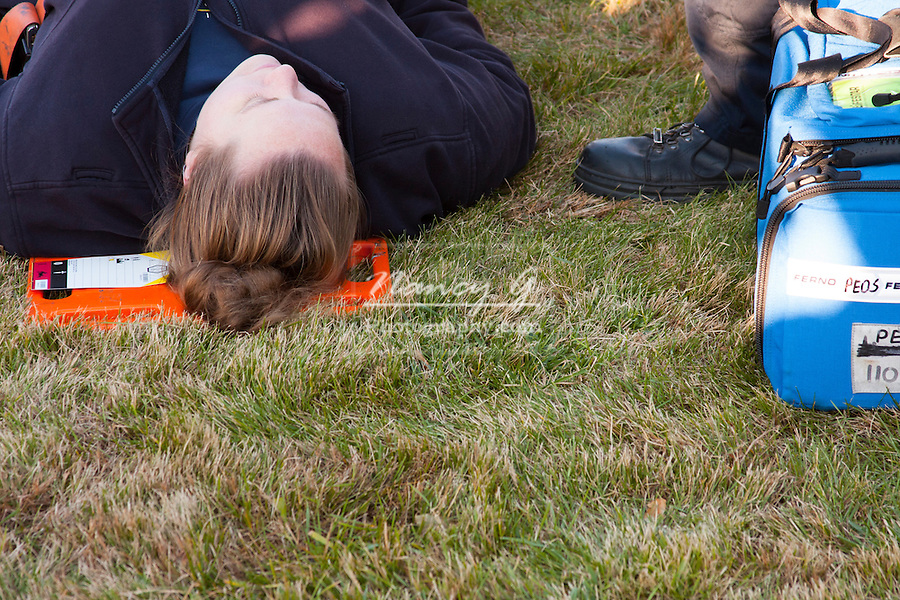 A female victim laying on a backboard with an immedicate response tag at a mass cassualty event