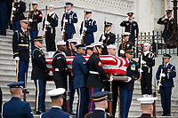 The flag-draped casket of former President George H.W. Bush is carried by a joint services military honor guard from the U.S. Capitol, Wednesday, Dec. 5, 2018, in Washington. <br /> Credit: Shawn Thew / Pool via CNP / MediaPunch