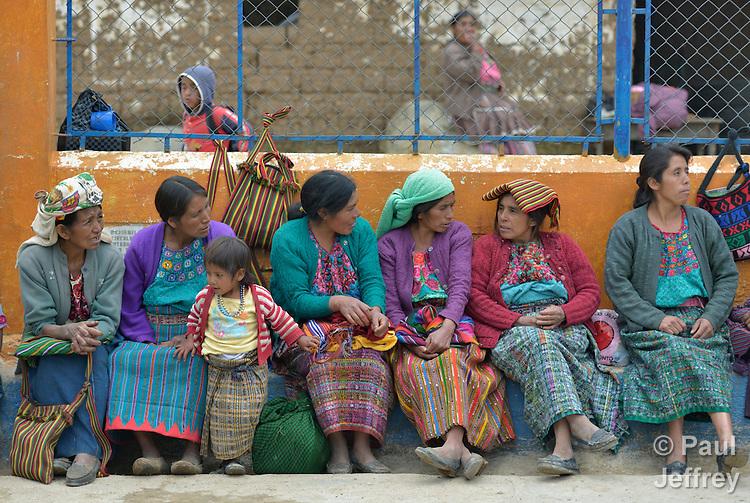 Indigenous women watch other women play basketball in Tuixcajchis, a small Mam-speaking Maya village in Comitancillo, Guatemala.