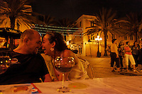 Espanola Way with restaurants, cafes and outside seating in a lively neighborhood tucked away from the beach scene..Tatiana Mailliard and her husband Roger at Tapas y Tintos talk and laugh as people stroll by the restaurants in the evening.
