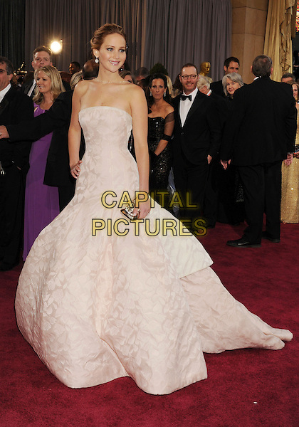 Jennifer Lawrence (wearing Dior Haute Couture).85th Annual Academy Awards held at the Dolby Theatre at Hollywood & Highland Center, Hollywood, California, USA..February 24th, 2013.oscars full length white pale pink strapless dress gown voluminous clutch bag full-tiered skirt.CAP/ROT/TM.©Tony Michaels/Roth Stock/Capital Pictures