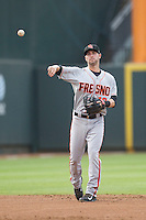 Fresno Grizzlies shortstop Nick Noonan (12) makes a throw to first base during the Pacific Coast League baseball game against the Round Rock Express on June 22, 2014 at the Dell Diamond in Round Rock, Texas. The Express defeated the Grizzlies 2-1. (Andrew Woolley/Four Seam Images)
