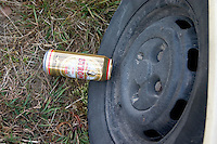 Beer can resting in peace on tire.  Zawady   Central Poland
