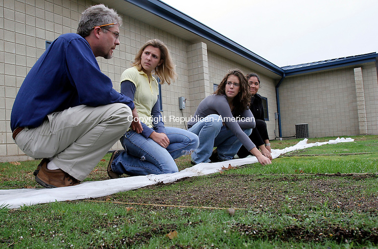 WOODBURY, CT-13November 2006-111306TK11- (left to right) Eric Birkenberger, Horticulture teacher of a landscaping class with students Kim Zavodjancik of Naugatuck, Emily Kalenauskas of Watertown and Sara Paetsch of Sherman inspect the growth progress of common grasses used in landscaping.  Tom Kabelka Republican-American (Eric Birkenberger, Kim Zavodjancik, Emily Kalenauskas, Sara Paetsch)