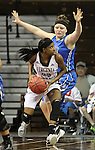 SIOUX FALLS MARCH 22:  Taylor White #25 of Virginia Union drives toward Victoria Lux #32 of Bentley during their quarterfinal game at the NCAA Women's Division II Elite 8 Tournament at the Sanford Pentagon in Sioux Falls, S.D. The ball bounced off the rim as Bentley won 53-52. (Photo by Dick Carlson/Inertia)