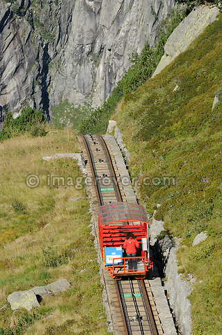 Switzerland, Western Europe, Grimsel region, nr. Guttannen, Gelmerbahn funicular. Note: No releases available. --- Info: The Gelmer cable car funicular railway with a maximum incline of 106 percent is Europe's steepest cable car. The Gelmer Railway was built in the 1920s to help with the construction of the Lake Gelmer water reservoir dam. Originally used for freight the cable car was converted to a passenger railway in 2001. The 12 minutes and one kilometer long ride in the open carriages overcomes a 450 meters height difference and takes one up to Lake Gelmer at an altitude of 1860 meters above sea level. The region where the reservoir is located is the starting point for hikes and mountain tours.