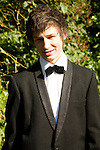 Model released portrait of young man wearing bow tie and suit jacket dressed for his school prom