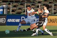 Leslie Osborne (10) kicks the ball ahead of Camile Abily (20) and Aya Miyama (right). FC Gold Pride tied the Los Angeles Sol 0-0 at Buck Shaw Stadium in Santa Clara, California on July 23, 2009.