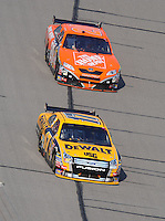 Sept. 28, 2008; Kansas City, KS, USA; Nascar Sprint Cup Series driver Matt Kenseth leads Tony Stewart during the Camping World RV 400 at Kansas Speedway. Mandatory Credit: Mark J. Rebilas-