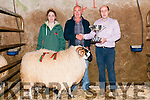 Nelius McAuliffe (Manager Dingle Mart) presenting the West Kerry Scotch Mountain Yearling Ram Champion trophy to Tom Greaney (owner, Flemings Town Annascaul) and his daughter Aoife during the Scotch Yearling ram and sheep sale at the Dingle Mart on Sunday.