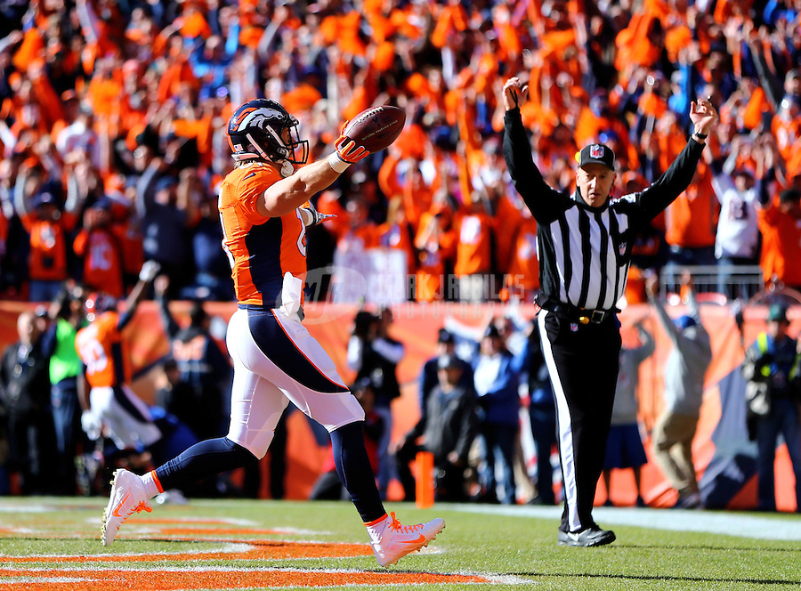 Jan 24, 2016; Denver, CO, USA; Denver Broncos tight end Owen Daniels (81) celebrates after scoring a first quarter touchdown against the New England Patriots in the AFC Championship football game at Sports Authority Field at Mile High. The Broncos defeated the Patriots 20-18 to advance to the Super Bowl. Mandatory Credit: Mark J. Rebilas-USA TODAY Sports