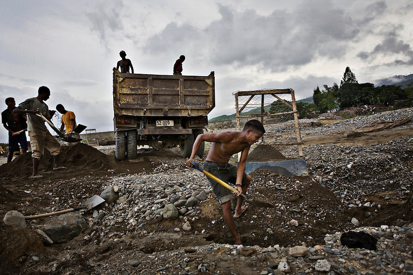 East Timorese laborers dig gravel from the bed of the Comoro River to supply construction projects in Dili, East Timor, January 3, 2010. These laborers earn approximately $10 to $20 a day.