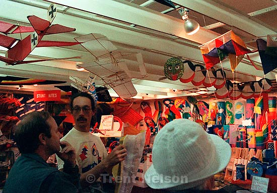 Steve Nelson and Betty Rae Watts (white hat) in a Chinatown kite shop, 1987.<br />