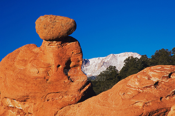 Rock formation and Pikes Peak at Sunrise, Garden of The Gods National Landmark, Colorado Springs, Colorado, USA