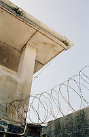 Razor wire covers the old prison wall at Robben Island Museum, near Cape Town, South Africa