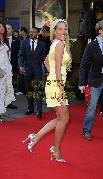 """DANIELLE LLOYD.World Premiere of """"Adulthood"""" held at the Empire Leicester Square, London, England, UK, June 17th 2008.arrivals full length yellow dress hairband silver shoes back over shoulder smiling clutch bag purse.CAP/ROS.©Steve Ross/Capital Pictures"""
