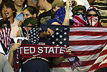 06 September 2008: U.S. fans who travelled to Cuba cover their faces. The United States Men's National Team defeated the Cuba Men's National Team 1-0 at Estadio Nacional de Futbol Pedro Marrero in Havana, Cuba in a CONCACAF semifinal round FIFA 2010 South Africa World Cup Qualifier.