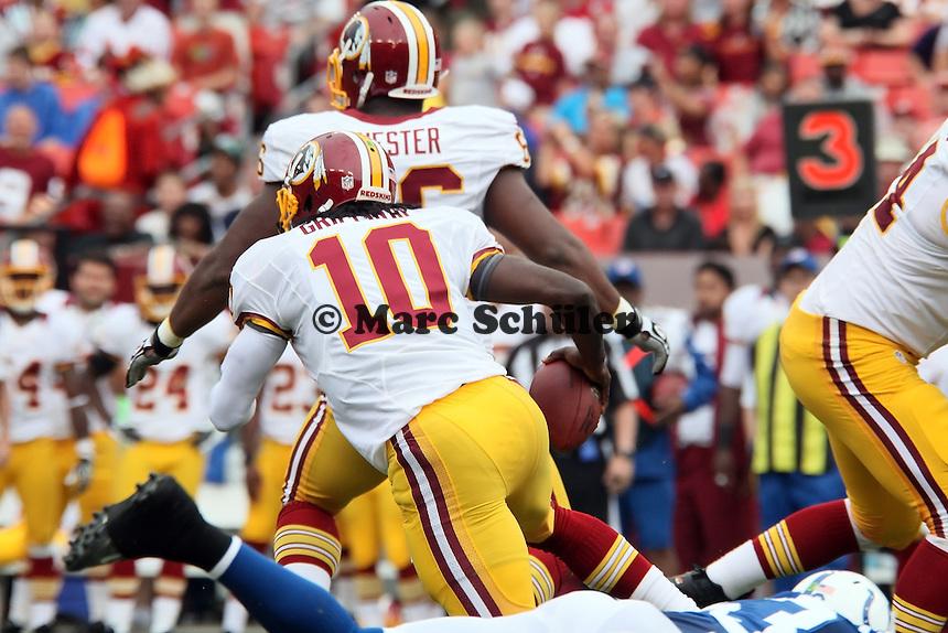 QB Robert Griffin III (Redskins) laeuft selber mit dem Ball