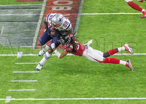 February 5th 2017, Houston, Texas, USA;   Atlanta Falcons cornerback Jalen Collins (32) tackles New England Patriots tight end Martellus Bennett (88) during the New England Patriots 34-28 victory over the Atlanta Falcons