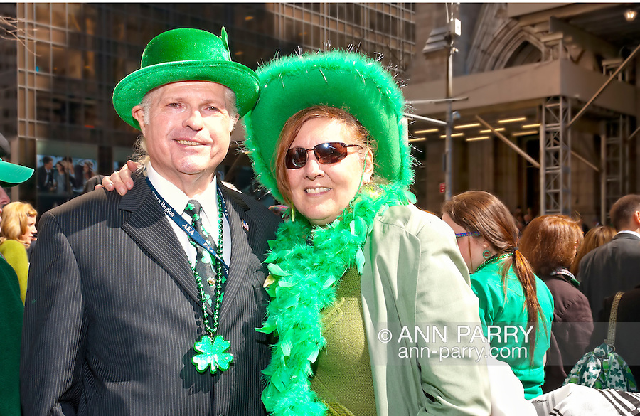 MARCH 17, 2011 - MANHATTAN: Couple at St. Patrick's Day Parade NYC across from St. Patrick's Cathedral on 5th Avenue between E 50 and E 51 St