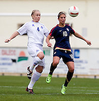 USWNT midfielder (10) Carli Lloyd tries to keep possession of the ball away from Iceland's (4) Edda Gardarsdottir during the Algarve Cup.  The USWNT defeated Iceland, 1-0, at Ferreiras, Portugal.