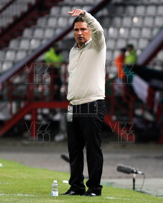 MANIZALES -COLOMBIA- 04 -12 -2013. Jose Flabio Torres tecnico del Deportivo Pasto. Accion de juego entre los equipos Once Caldas contra Deportivo Pasto , encuentro de los cuadrangulares finales de la Liga Postobon jugado en el estadio Palogrande  / Jose Flabio Torres coach of Deportivo Pasto, Action game between teams Once Caldas vs Deportivo Pasto, meeting the end-runs Postobon League played in the stadium Palogrande.Photo: VizzorImage / Santiago Osorio / Stringer