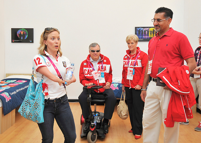 LONDON, ENGLAND 09/08/2012  The Lieutenant Governor of Ontario David Onley, Ruth Ann Onley and Minister of State (Sport) Bal Gosal during a tour of the Athlete's Village with Elisabeth Walker-Young at the London 2012 Paralympic Games.  (Photo by Matthew Murnaghan/Canadian Paralympic Committee)