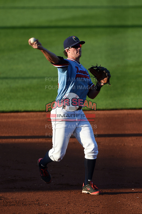 Cedar Rapids Kernels third baseman Logan Wade (13) throws to first during a game against the Quad Cities River Bandits on August 19, 2014 at Perfect Game Field at Veterans Memorial Stadium in Cedar Rapids, Iowa.  Cedar Rapids defeated Quad Cities 5-3.  (Mike Janes/Four Seam Images)
