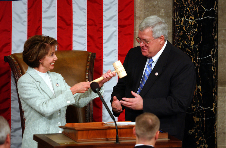 House5_010703 -- Nancy Pelosi, D-CA., hands the gavel to J. Dennnis Hastert, R-Ill., after she conceded the race for the Speaker of the House during the opening session of the 108th Congress. Pelosi was the first female to contest the seat.