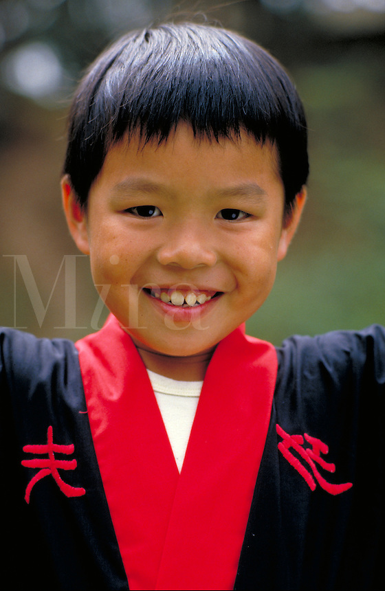 CHINESE-AMERICAN BOY (9) IN HIS MARTIAL ARTS UNIFORM. CHINESE-AMERICAN BOY (9). SAN FRANCISCO CALIFORNIA.