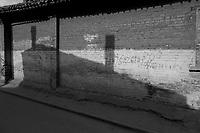 Daytime horizontal view of a road running through the siheyuan lined hútòng in the old part of Dàtóng Shì Chéng Qū in Shānxī Province, China  © LAN