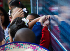 Oct. 4, 2013; Students from St. Rita School in Ft. Worth, TX point to their schoo's name on the side of the The Alliance For Catholic Education (ACE) bus.  ACE kicked off its Fighting For Our Children&rsquo;s Future National Bus Tour during the Shamrock Series events in Dallas and Fort Worth.<br /> <br /> Photo by Matt Cashore/University of Notre Dame