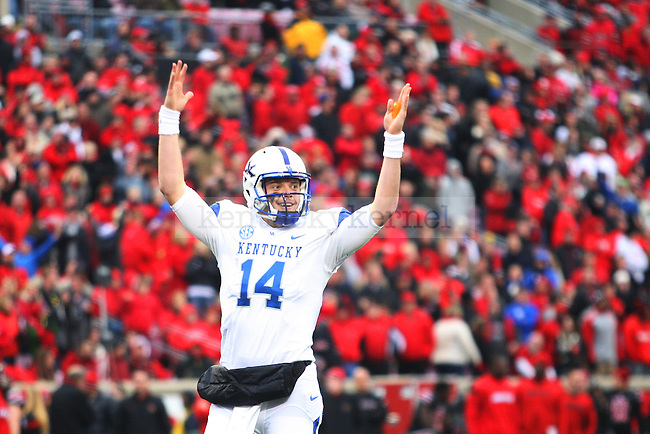Quarterback Patrick Towles of the Kentucky Wildcats celebrates a touchdown during the second half of the game against the Louisville Cardinals at Papa Johns Cardinals Stadium on Saturday, November 29, 2014 in Louisville, Ky. Louisville defeated Kentucky 44-40. Photo by Michael Reaves | Staff