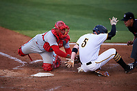 Clearwater Threshers catcher Deivi Grullon (13) puts a tag on Bradenton Marauders second baseman Mitchell Tolman (5) as he slides into home plate during a game against the Bradenton Marauders on April 18, 2017 at LECOM Park in Bradenton, Florida.  Clearwater defeated Bradenton 4-2.  (Mike Janes/Four Seam Images)