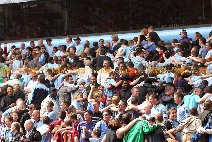 Manchester City fans do the 'Poznan' after scoring the third goal -  Chelsea vs Manchester City at the Villa Park Stadium - 12/08/12 - MANDATORY CREDIT: Dave Simpson/TGSPHOTO - Self billing applies where appropriate - 0845 094 6026 - contact@tgsphoto.co.uk - NO UNPAID USE.