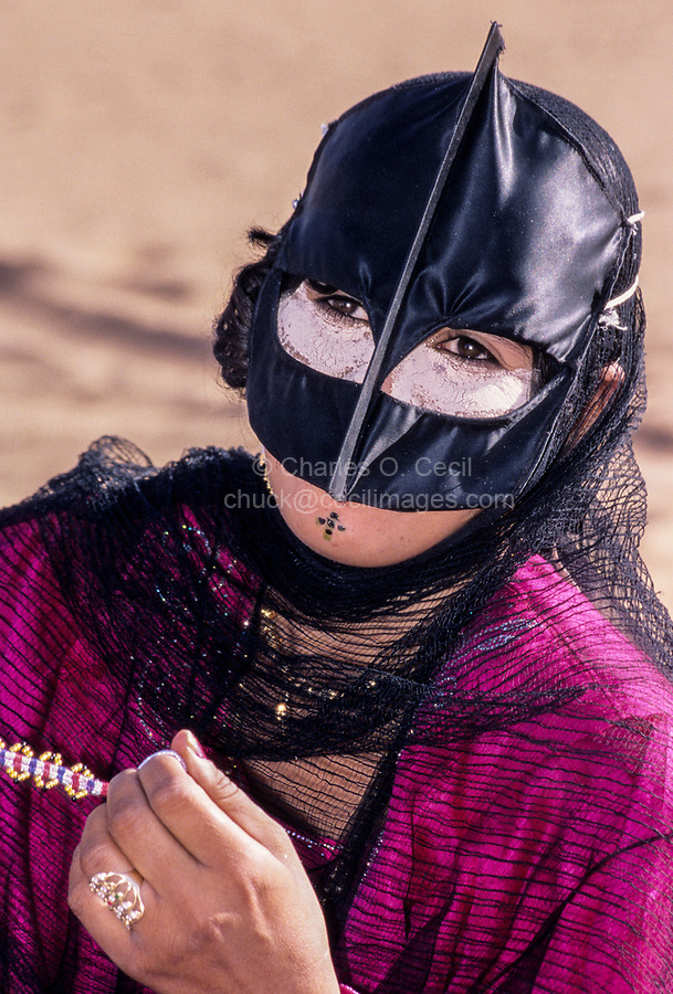 Wahiba Sands, Oman.  Bedouin Lady in Mask, with Chin tattoo.